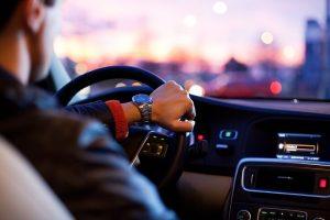 Man Steering Car